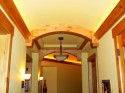 Arched Box Beam and light valance in Knotty Alder